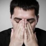Men sad with hemorrhoids